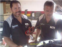 Effrain and Robert using one of our 4 different scanners to accurately diagnose a check engine light!